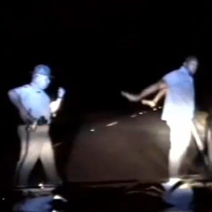 A still image from a traffic stop involving a state trooper and NFL player Sam Montgomery.