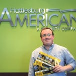 One of the winners in the Hattiesburg American's contest for Southern Miss season football tickets displays his tickets.