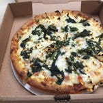 The spinach and feta pizza from Founaris Brothers Greek Restaurant.