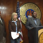 Monroe Mayor Jamie Mayo (at podium) discusses SEDD donation resolution. Also pictured are SEDD Executive Director Gregg Smith and city attorney Nanci Summersgill