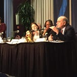 Civil rights attorney Al Gerhardstein (right) speaks Tuesday night on a panel about the civil unrest of 2001.