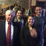 George Harnen, president of the Dr. Victor Bacile Scholarship Fund, with scholarship winners Carly Jobson, Janine Marie Rossi and Jordon Outwater.