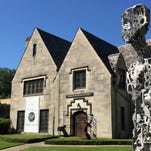 A towering sculpture stands near the entrance to Masur Museum of Art.