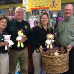 Waukesha Sheriff's Citizens Academy board member Sharon Kapps, academy president Charles Dahm and Waukesha County Sheriff's Department deputy sheriff Jennifer Wallschlaeger joined Learning Shop co-owner Todd Merryfield Monday afternoon when the store donated 75 plush teddy bears courtesy of Bears for Humanity.