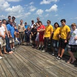 A group of volunteers including Connor Dunne, 16, helped make improvements to the Eau Gallie Pier on Saturday. Dunne spearheaded the effort as part of a yearlong project with Boy Scout Troop 373 based out of Ascension Catholic Church in Melbourne.