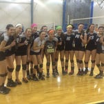 South Lyon East volleyball players celebrate the program's first tournament title.