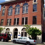 The renovated Odd Fellows Hall, 211-215 W. Muhammad Ali Blvd., now used by the city's PARC operation, would remain for now on a site for future development.