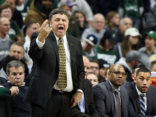 Dec 21, 2016; East Lansing, MI, USA;  Oakland Golden Grizzlies head coach Greg Kampe reacts to a play during the first half of a game against the Michigan State Spartans at Jack Breslin Student Events Center.