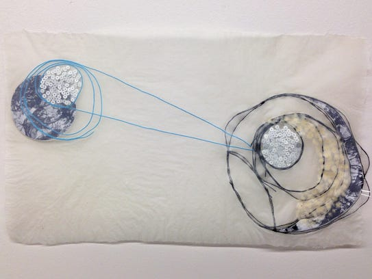 An embedded paper work by Detroit artist Megan Heeres,