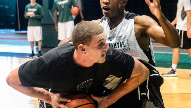 Binghamton University forward Bobby Ahearn, seen here with the ball during a practice in the Events Center in July 2014, averaged 4.7 points and 4.1 rebounds per game while shooting 52 percent from the floor as a freshman.