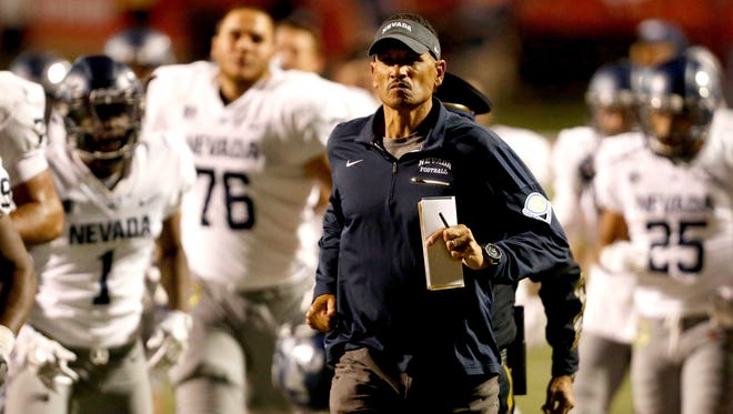 Wolf Pack head coach Jay Norvell leads his team onto the field during their game against Fresno State last week.