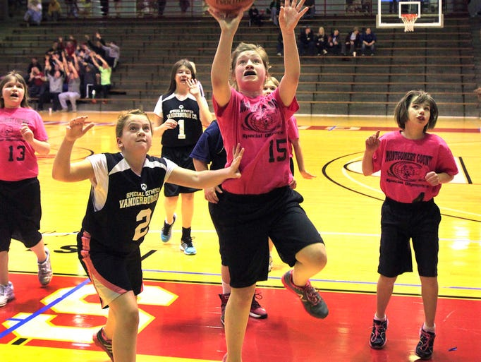 A Montgomery County Panther player drives to the basket during a semifinal game with the Vanderburgh County Knights in the 2014 Special Olympics Indiana State Youth Basketball Tournament at the University of Indianapolis on Saturday, March 22, 2014.