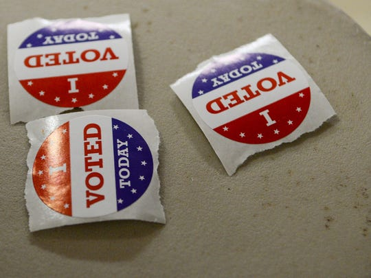 Voting stickers during city voting at Anderson precinct 3/1 at the Anderson University Sports Complex on Tuesday.