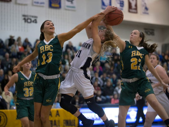 Manasquan's Stella Clark gets double teamed  as she