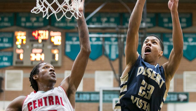 Desert Vista High's Brandon Clarke puts up a shot as Central High's Famoun Miller defends during the second half of the Division I super sectional first-round boys basketball game at Highland High School in Gilbert Wednesday, February 11, 2015. No. 7 Desert Vista and No. 8 Central both have byes in the first round of the Div. I state tournament.