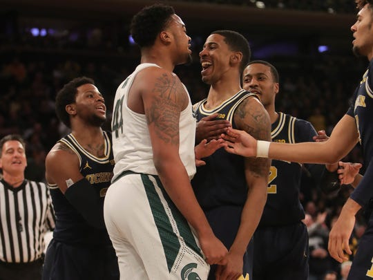 Michigan State forward Nick Ward mixes it up with Michigan guard Charles Matthews during first half action of the Big Ten Tournament semifinal Saturday, March 3, 2018 at Madison Square Garden in New York.