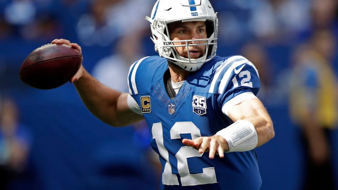 FILE - In this Sunday, Sept. 30, 2018, file photo, Indianapolis Colts quarterback Andrew Luck throws during the first half of an NFL football game against the Houston Texans in Indianapolis. Luck's surgically-repaired right shoulder is being tested in ways even he couldn't anticipate a month ago. The Colts quarterback officially threw 121 passes during a five-day stretch last week, easily the highest total he's ever accrued in consecutive games.(AP Photo/Michael Conroy, File)