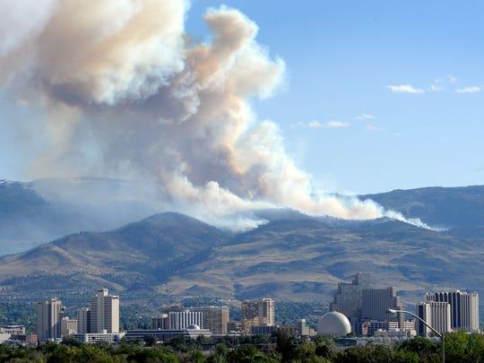 The Hunter Falls Fire sends smoke above Reno earlier this summer.