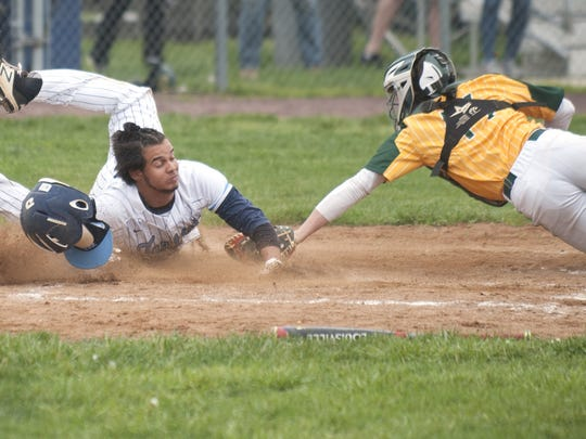 Highland's Dylan Maria scores before Clearview catcher Brian Clark can make the tag in the sixth inning of Monday's Tri-County Royal game.