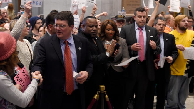 House Democratic Caucus Chairman Mike Stewart and Rep. Antonio Parkinson, D-Memphis, join in protesters' chants and shake hands at the Tennessee state Capitol on Jan. 30, 2017.