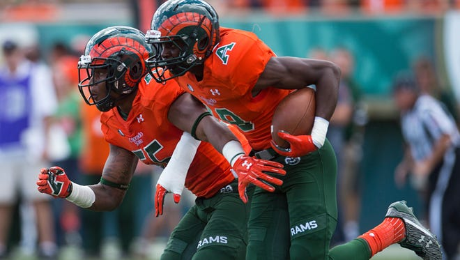 CSU safety Braylin Scott, who  could have played basketball instead of football in college, returns an interception alongside  linebacker Josh Watson during Saturday's 47-21 win over Northern Colorado at Hughes Stadium.