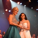 Miss Hospitality 2015 Erin Morgan of Laurel hands Ashley Luthje of Marion County an award during the 2016 Miss Hospitality Pageant at the Saenger Theater on Friday.