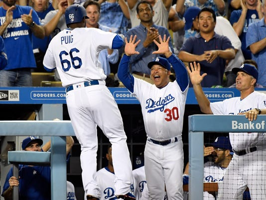 b2c1ef2a330f5 Dodgers manager Dave Roberts  Yasiel Puig  earned the right to be a ...