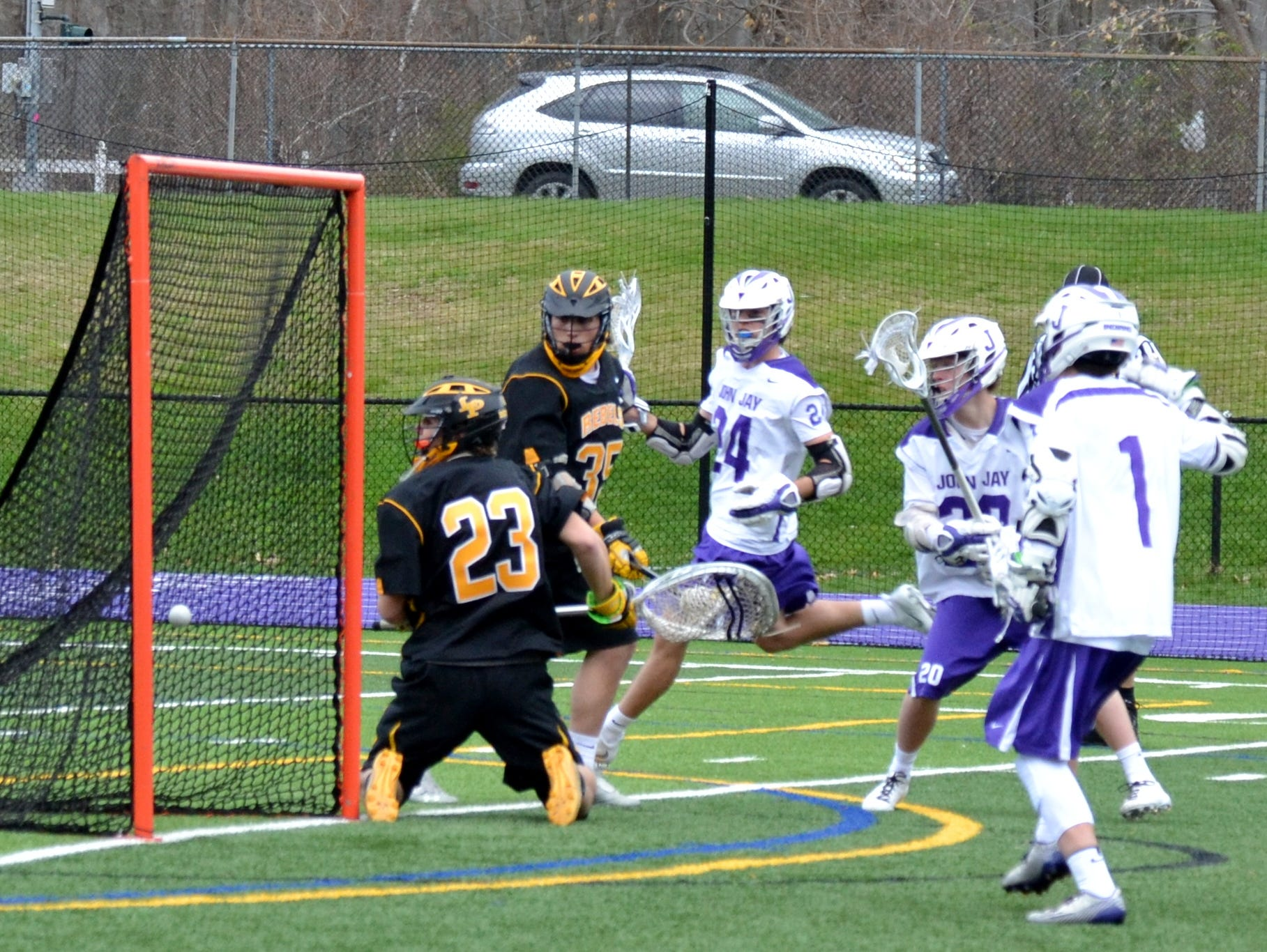 John Jay midfielder Gus Carlson (20) scores in the final minutes of regulation to give the Indians an 8-7 lead.