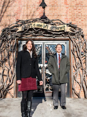 Leah Wong Ashburn, left, and Oscar Wong stand outside Highland Brewing's taproom Wednesday. Ashburn is taking over from her father and Highland founder Wong, in what looks to be a year of changes for Highland.