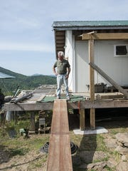 A work in progress, Tom Mincarelli's home is a mere three miles from Black Mountain, as the crow flies.