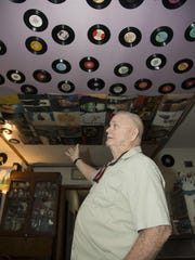 Bob LaBrant, a big Elvis fan, doesn't think there's anything strange about having 45s on your ceiling.