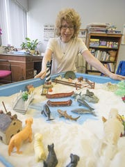 Andrea Wasser-Malmud, Licensed Clinical Social Worker, Chief Professional Officer of New Bridge in Mountain Lakes, with a sand tray for clients, at the New Bridge office in Mountain Lakes, July 13, 2015.