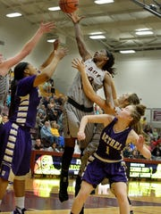 Freed-Hardeman's Kim Mallory goes up for a rebound over Bethel University defenders during their game Tuesday evening at FHU.