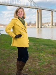 Kay Estrada, a registered nurse from Middletown, wears a yellow wool pea-coat, and green-brown-and-white scarf from Talbots, over denim jeggings from White House Black Market.