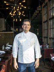 Posana executive chef Peter Pollay stands inside his