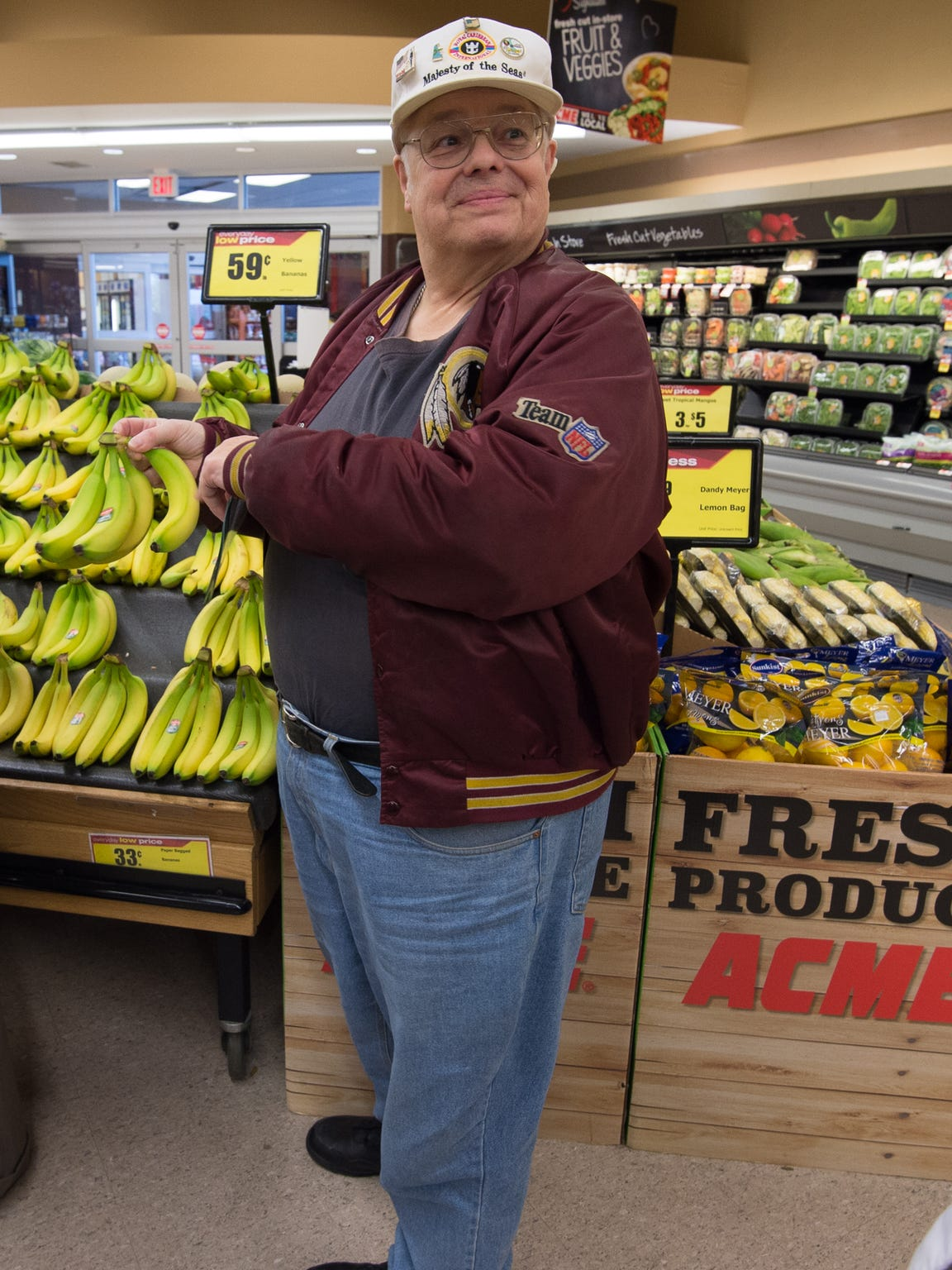 Dover resident Gary Stumpf points at bananas during a diabetes care program tour at the Dover Acme grocery store on April 9. Stumpf  was diagnosed with Type 2 diabetes more than two decades ago.
