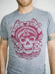 T-shirt from Acanthus Apparel.