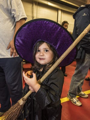 Witch Alexandra Kline, 3, of at the Denville Halloween party held at the Main street firehouse substituting for the annual Halloween parade, October 30, 2016.