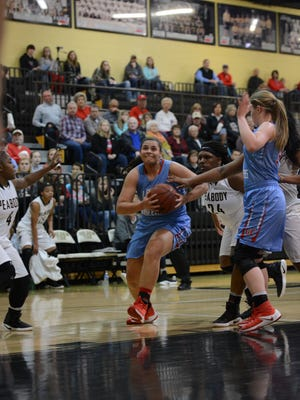 Gibson County's Justyce White drives to the basket against Trenton Peabody.