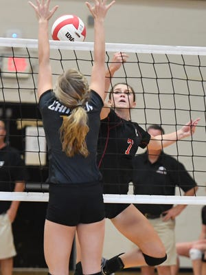 South Side's Ashlynne Clifft attempts to get the ball over Camden's Sydney Baker during their game Sept. 7, 2017. Camden defeated South Side 3-0.