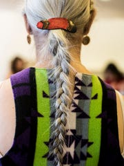 Gretchen Wilson's braid hangs across the design on her dress for the High Noon Indigenous Fashion Show, which takes place Thursday at the Paris Gibson Square Museum of Art.