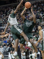 Michigan State's Cassius Winston, right, shoots as teammate Brock Washington defends during the annual Midnight Madness event on Friday, Oct. 20, 2017, at the Breslin Center in East Lansing.