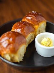 House yeast rolls with orange sorghum butter at Geist