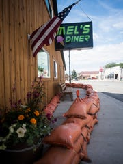 Sandbags protect the front of Mel's Diner Friday.