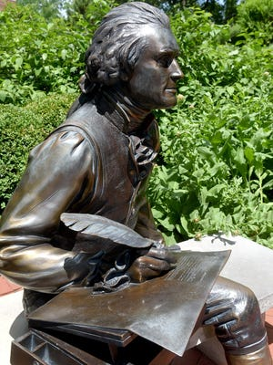The bronze statue of Thomas Jefferson on the University of Missouri campus. On Thursday, the UM Board of Curators sought to shield System President Mun Choi from criticism about a decision over the summer not to remove the statue in response to an online petition that called Jefferson a rapist for fathering children with enslaved woman Sally Hemings.