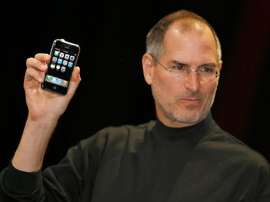 Apple chief executive Steve Jobs unveils the new mobile phone iPhone in 2007.