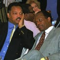 Barry and Jesse Jackson,talk during a luncheon held for the delegates to the fourth African-African American Summit held in Harare, Zimbabwe.