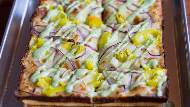 The Emmy pizza from Emmy Squared has mozzarella, banana peppers, red onion, ranch and side sauce.