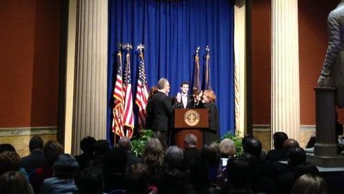 Louisville Mayor Greg Fischer takes oath to begin second term.