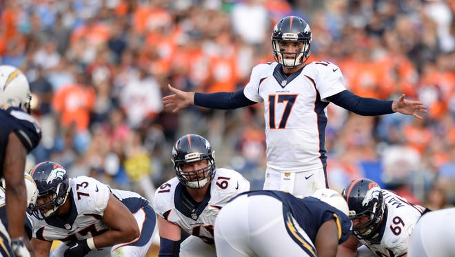 Denver Broncos quarterback Brock Osweiler (17) gestures during the fourth quarter against the San Diego Chargers at Qualcomm Stadium.